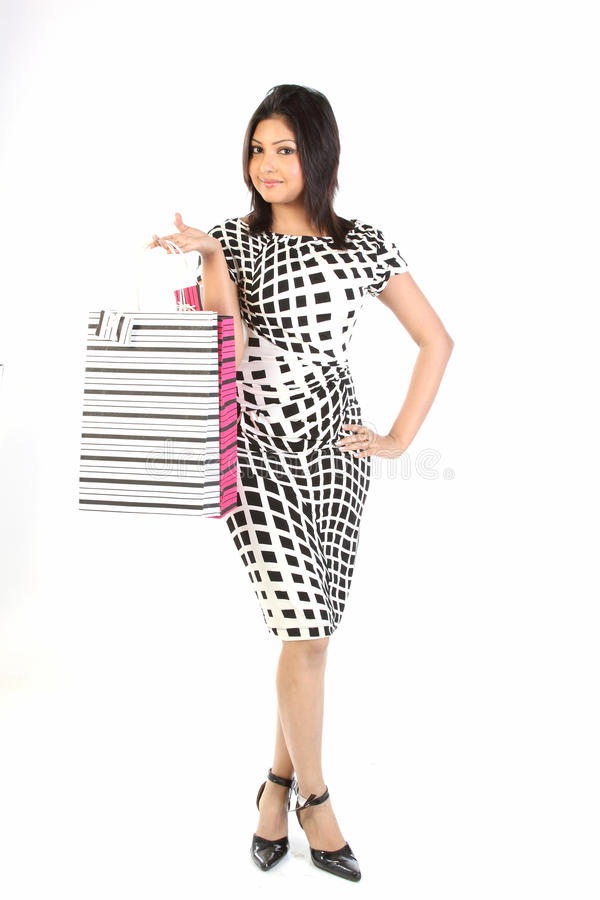 Indian woman with shopping bags stock photos