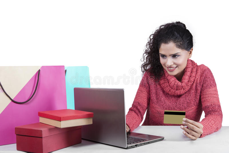 Indian woman shopping online isolated royalty free stock photography