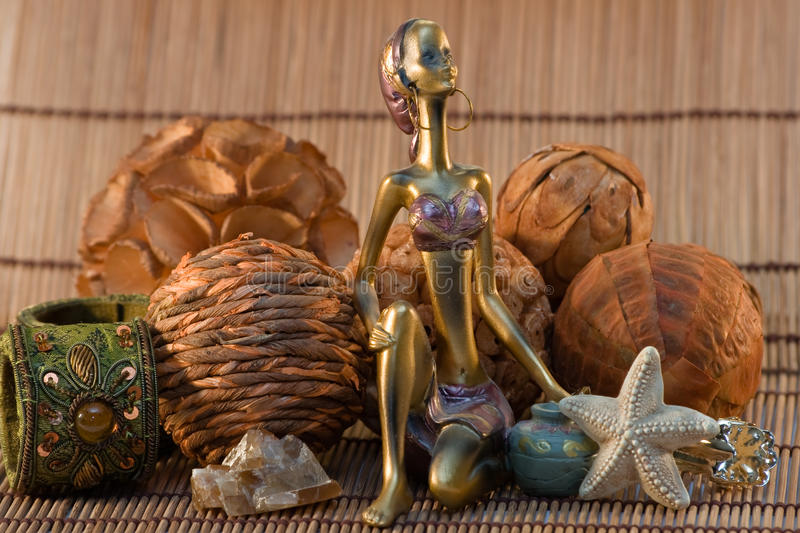 Indian woman statuette on wooden background royalty free stock photo