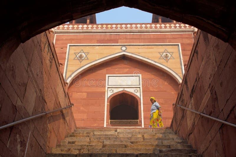 Indian woman walking at Humayun's Tomb, Delhi, India royalty free stock photography