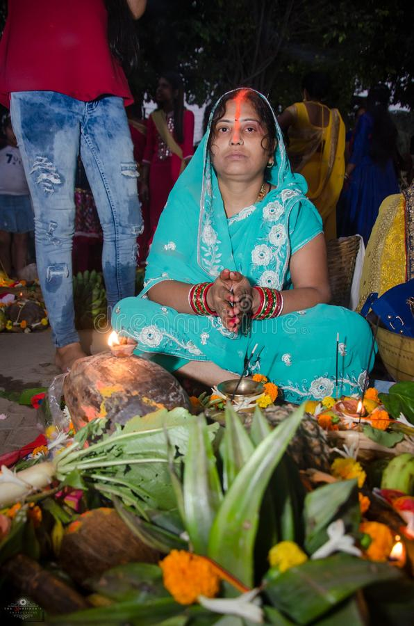 Indian women offering her prayers with fruits and bundle of bananas during the festival of Chhath Puja. Chhath is an ancient Hindu stock photography