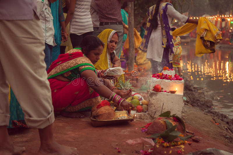 Indian women performing Chhath pooja. Indian women are performing rituals during Chhath puja, the festival to worship Sun god in India royalty free stock photo