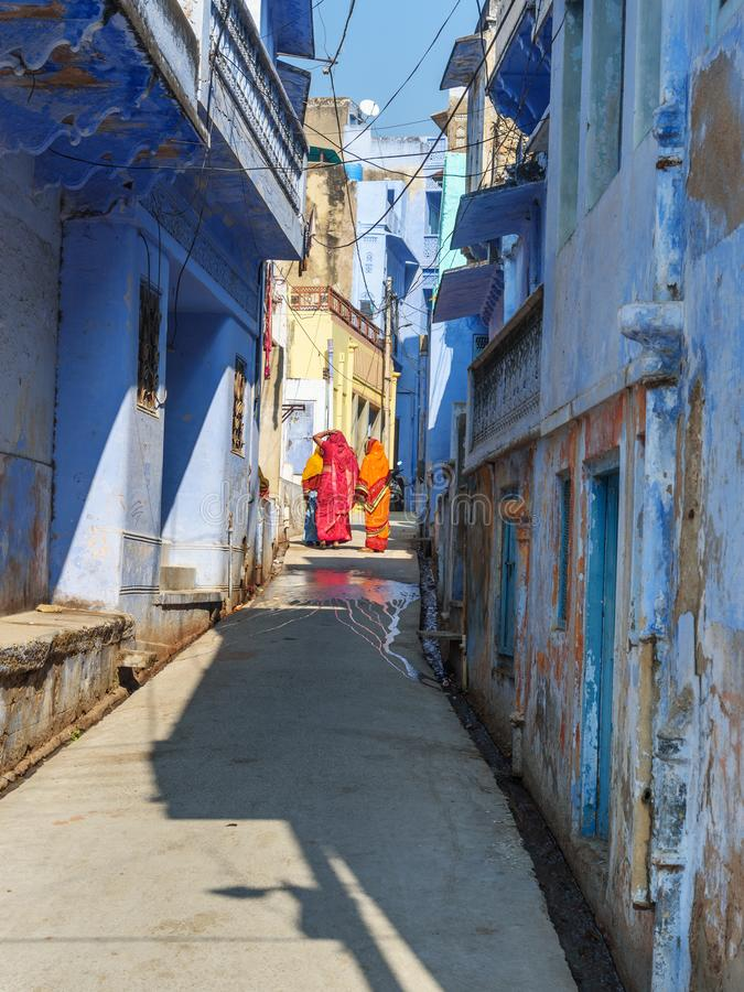 Indian women in sari on the blue street in Sambhar Lake Village. Rajasthan. India. Sambhar, India - February 03, 2019: Indian women in sari on the blue street in stock photo