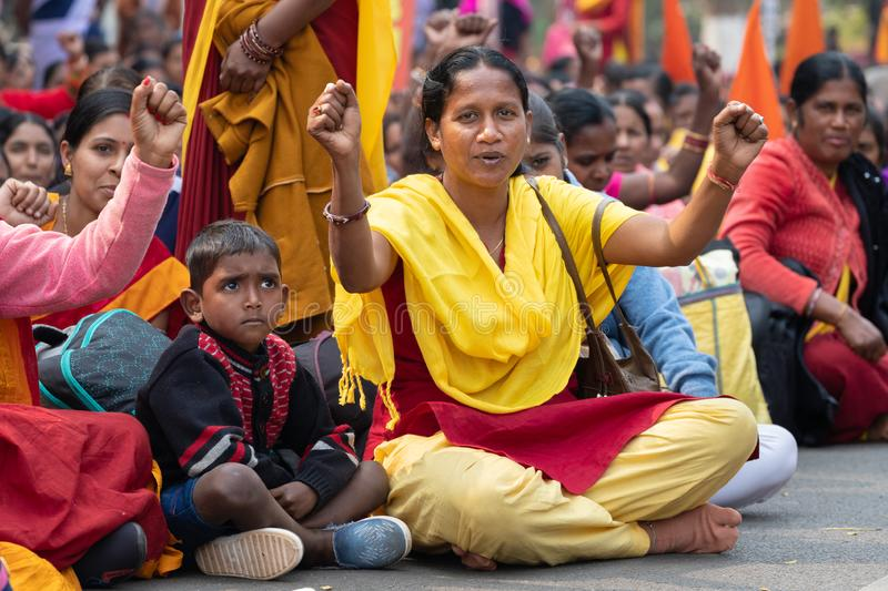 Indian women street demonstration. BHUBANESWAR, INDIA, JANUARY 11, 2019 : Women government officer and her son is protesting in the street against the income royalty free stock photo