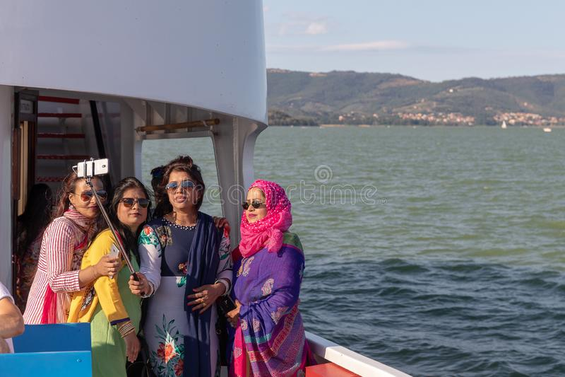 Indian women visiting Italy, taking selfies from the boat royalty free stock photography