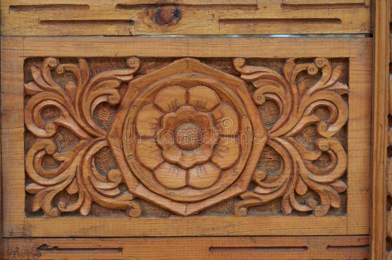 Indian wood ornament of door fragment stock photo