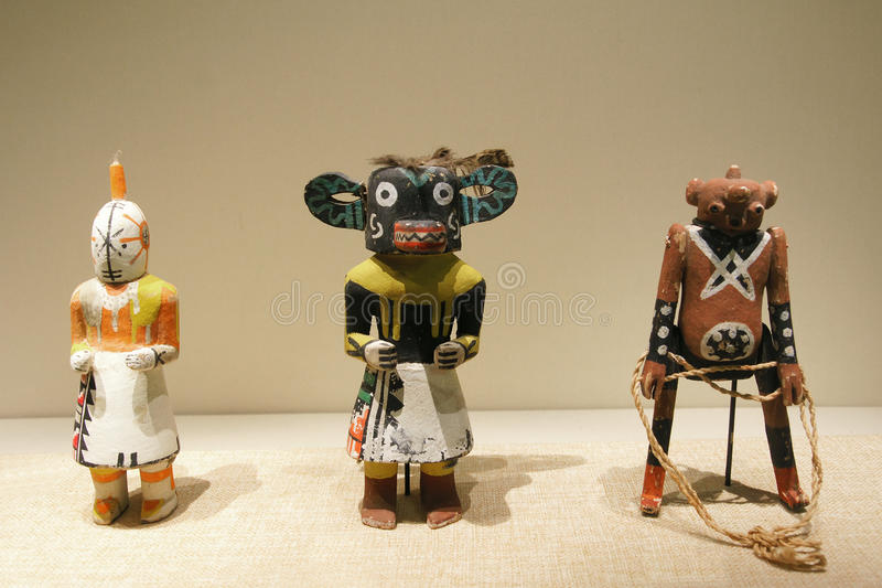 Indian wooden dolls. The close-up of ancient North American Indian wooden dolls royalty free stock photography