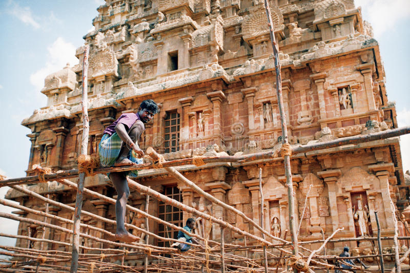 Indian worker against the temple royalty free stock images