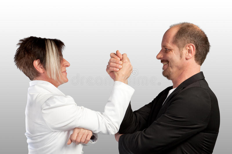 Indian wrestling. Two Business colleagues are doing an indian wrestling royalty free stock photography
