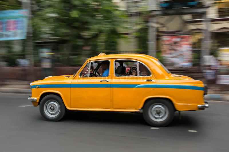 The Indian yellow Ambassador taxi cab driving on streets of Kolkata. India stock images