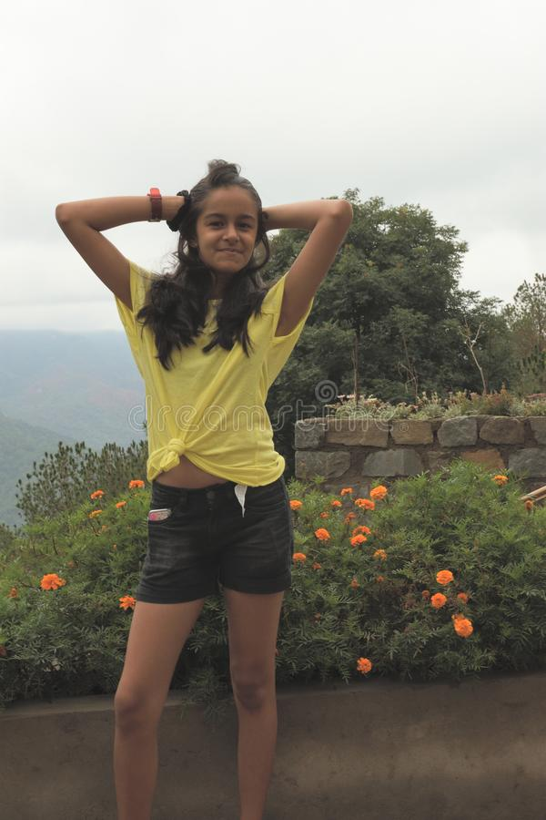 Indian young girl posing in style at a hill station on holiday royalty free stock image