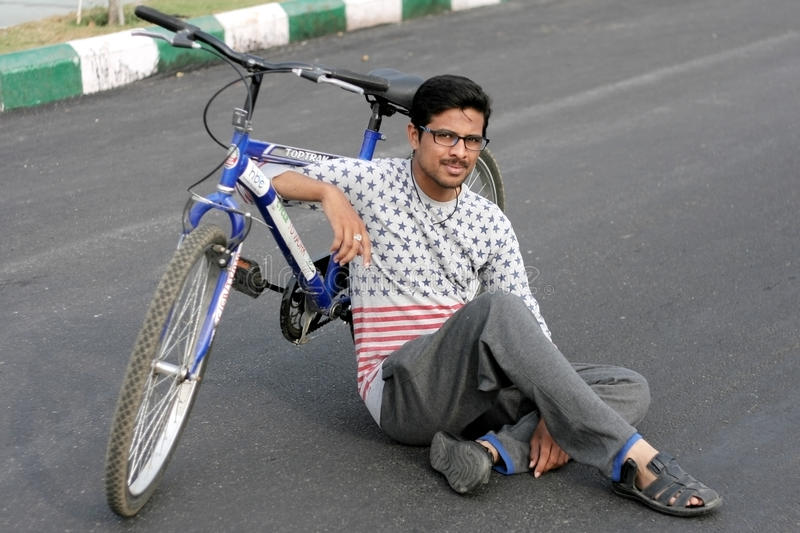 Indian young man member Hyderabad Bicycling Club rest on raahgiri day. On February 29,2016 in Hyderabad,India royalty free stock image