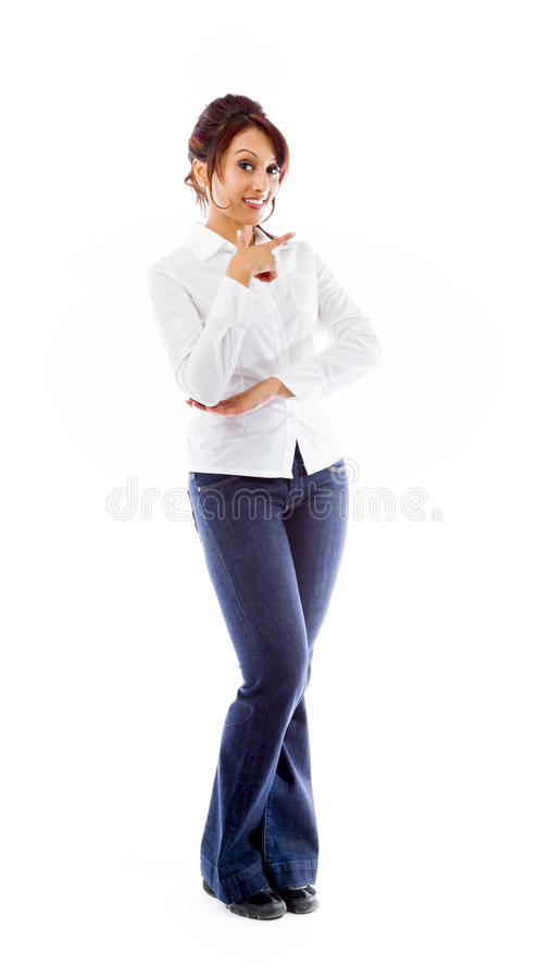 Indian young woman pointing backwards. Adult indian woman in studio isolated on white background stock photography
