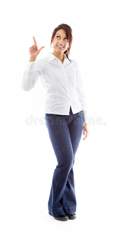 Indian young woman smiling and pointing upwards. Adult indian woman in studio isolated on white background royalty free stock photography