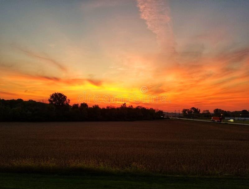 Indiana harvest sunrise. Early morning Indiana sunrise at harvest season stock photo