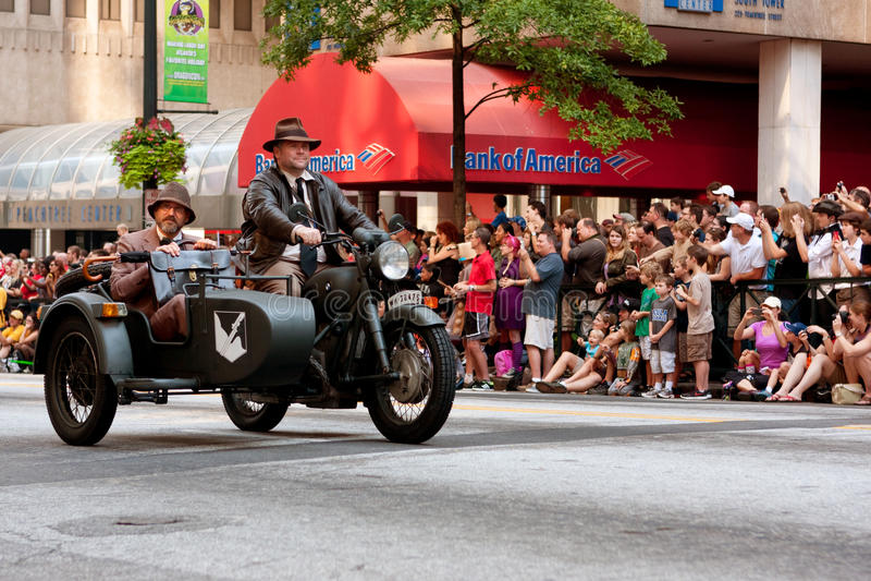 Indiana Jones Characters Ride Motorcycle In Atlanta Dragon Con Parade stock photography