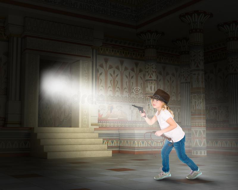 Indiana Jones, Imagination, Girl, Egypt, Pyramid. A young girl pretends to be Indiana Jones and uses her imagination to play inside an ancient Egyptian tomb stock photos