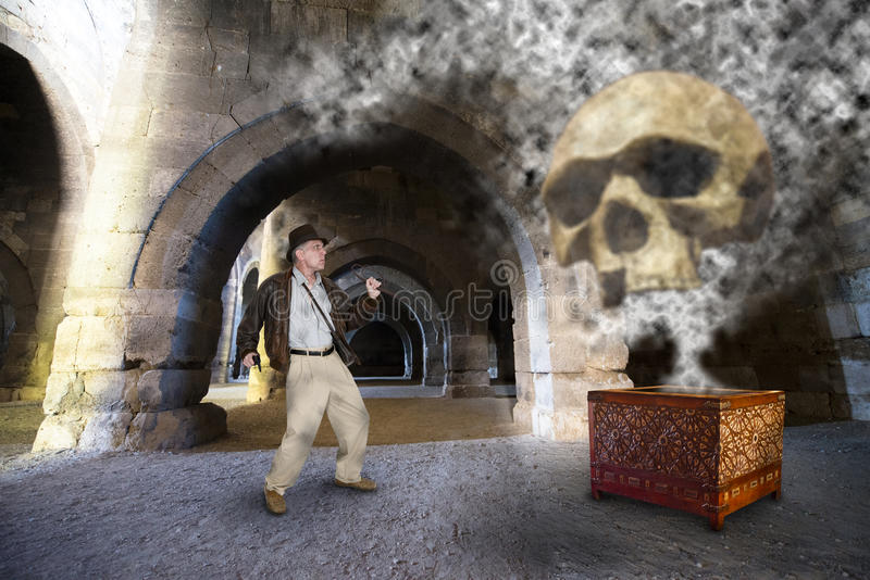 Indiana Jones Style Action Hero and Adventure. An Indiana Jones action hero character style shows our adventurer spirit by confronting an evil monster from stock photos