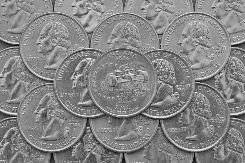 Indiana State and coins of USA. Pile of the US quarter coins with George Washington and on the top a quarter of Indiana State stock photography