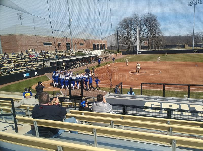 Indiana state players greet teammate at home plate stock images