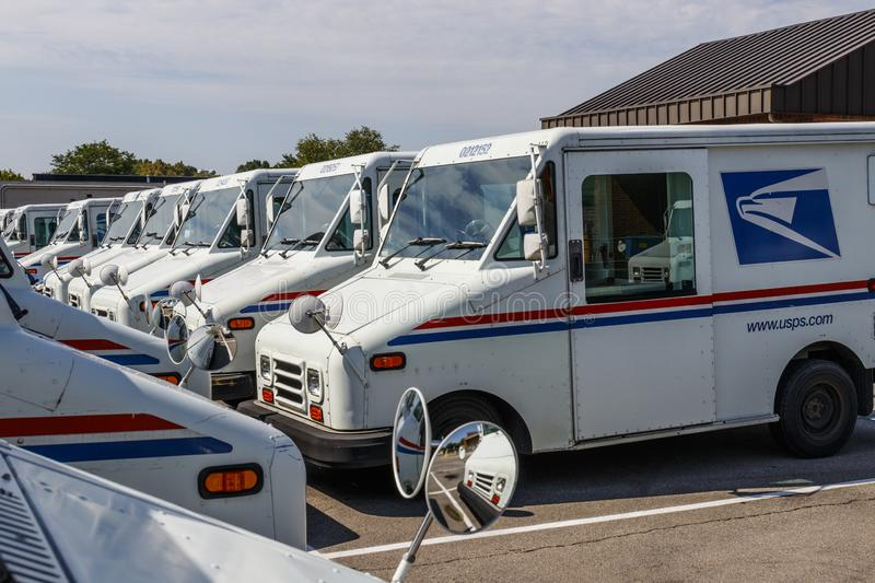 USPS Post Office Mail Trucks. The Post Office is responsible for providing mail delivery IX. Indianapolis - Circa August 2019: USPS Post Office Mail Trucks. The royalty free stock photos