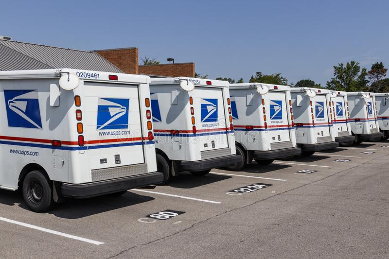 USPS Post Office Mail Trucks. The Post Office is responsible for providing mail delivery VII. Indianapolis - Circa August 2019: USPS Post Office Mail Trucks. The royalty free stock image