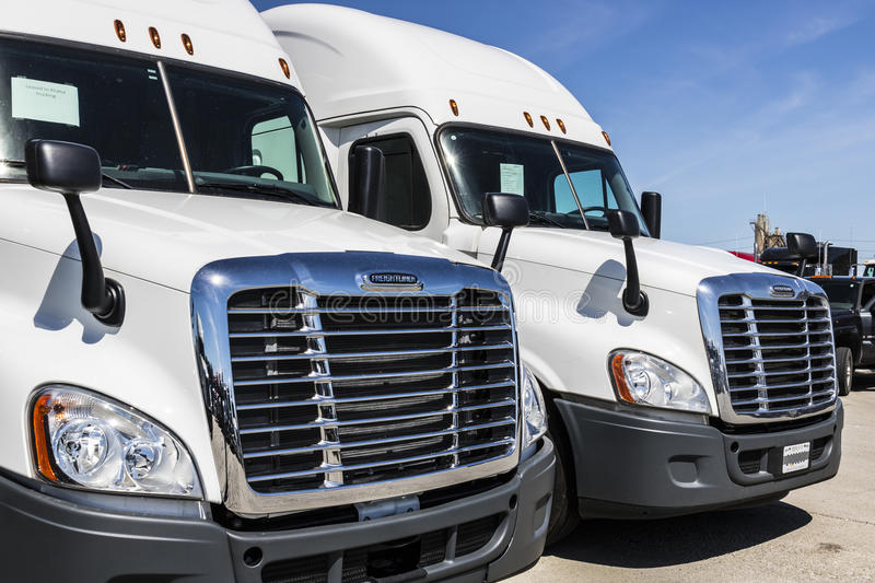 Indianapolis - Circa June 2017: Freightliner Semi Tractor Trailer Trucks Lined up for Sale VIII. Freightliner Semi Tractor Trailer Trucks Lined up for Sale VIII stock photography