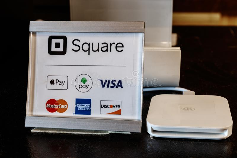 Indianapolis: Circa March 2019: Modern mobile credit methods including Square, Apple Pay, Android Pay, Visa, Master Card II. Modern mobile credit methods stock photo