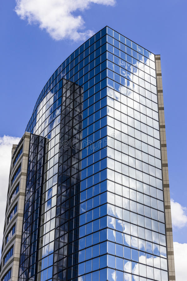 Indianapolis - Circa September 2016: Mirror Tile Window Skyscraper with Blue Sky and White Clouds in Reflection II stock images