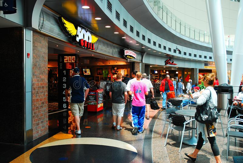 Indianapolis International Airport. Travelers walk amongst the restaurants and shops in the main atrium of the Indianapolis International Airport stock image