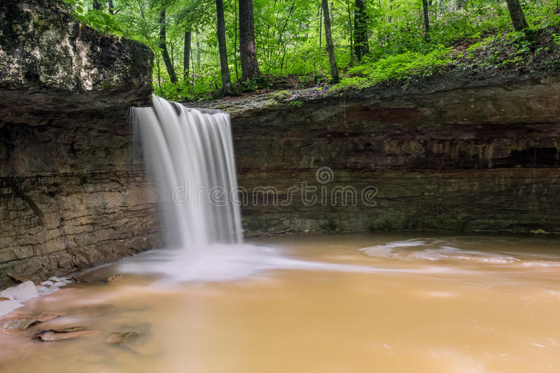 Indianas Rock Rest Falls. Rock Rest Falls, a waterfall in Jennings County, Indiana, plunges over a cliff and into a natural rocky amphitheater royalty free stock images
