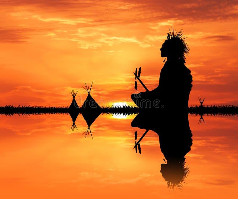 Indiano del nativo americano nella tenda al tramonto immagine stock libera da diritti