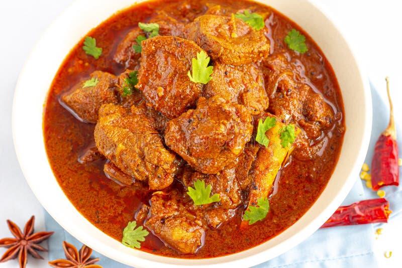 Indiano di Vindaloo dell'agnello autentico/curry rossi ardenti tradizionali di Goan dell'agnello immagine stock libera da diritti