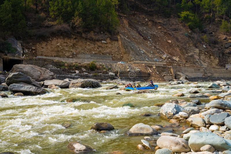 Indians go down the Beac mountain river near Kullu - sports rafting. 02/10/2019  Kullu  India . Indians go down the Beac mountain river near Kullu - sports stock image