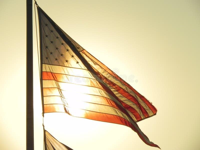 Indicador americano en la puesta del sol imagenes de archivo