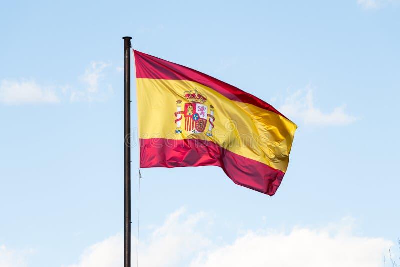 Indicador español que agita en el viento fotos de archivo