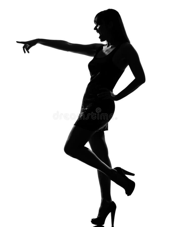 Indicare di risata della donna alla moda della siluetta fotografie stock