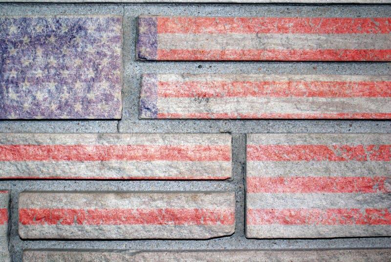 Indicateur américain sur le mur en pierre photographie stock libre de droits