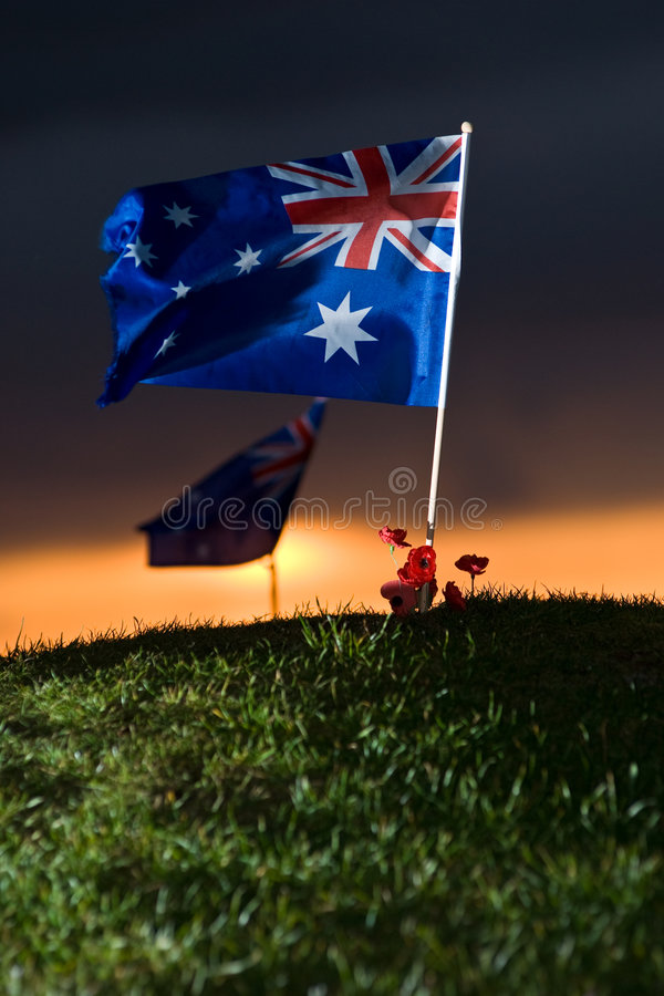 Indicateur australien sur une côte photos stock