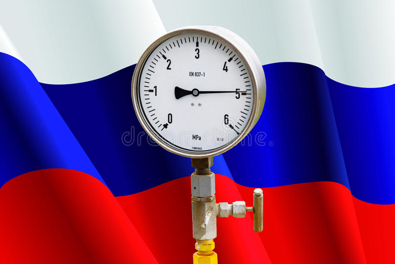 Indicateur de pression de tête de puits sur le drapeau Russie images stock