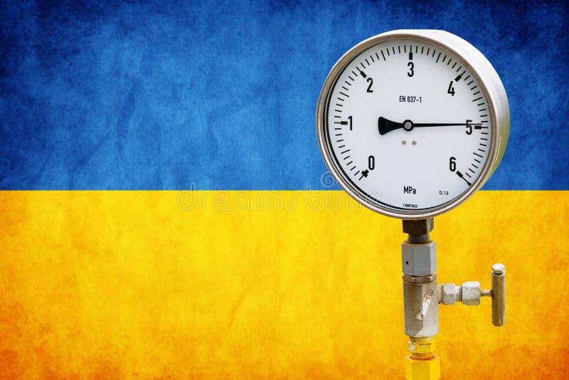 Indicateur de pression de tête de puits sur le drapeau Ukraine image libre de droits