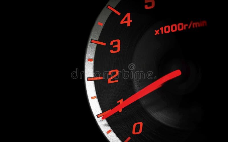 Indicateur de vitesse dans l'obscurité images libres de droits