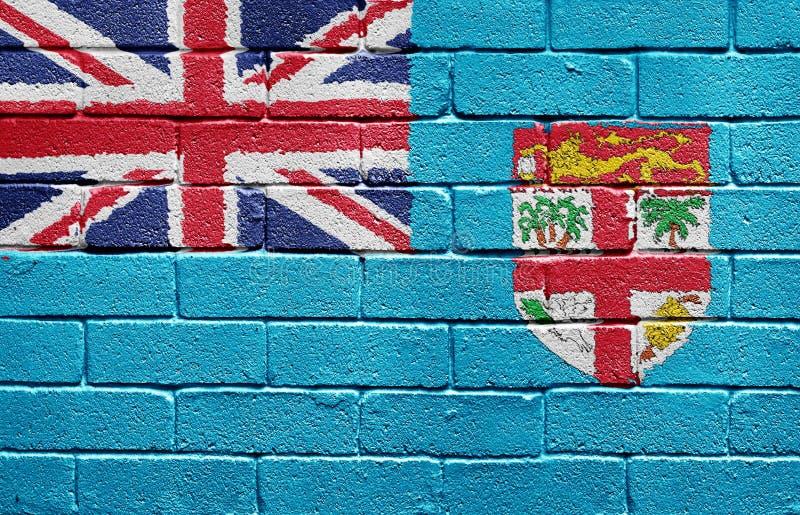 Indicateur du Fiji sur le mur de briques photographie stock
