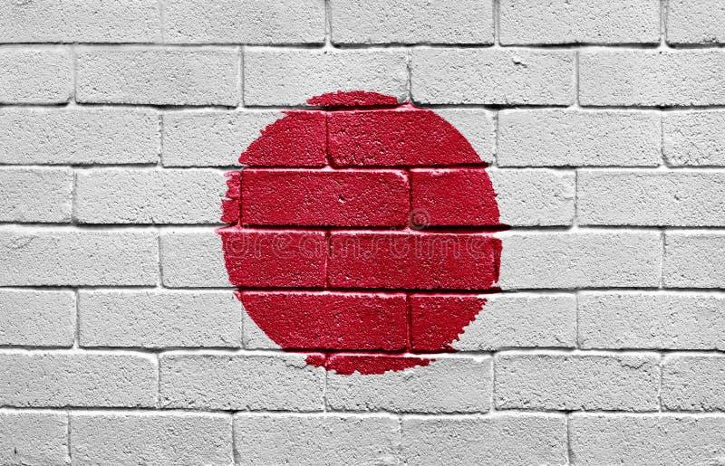 Indicateur du Japon sur le mur de briques photographie stock libre de droits