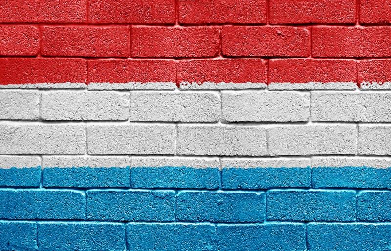 Indicateur du Luxembourg sur le mur de briques photo stock