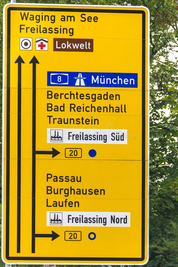 Indicating road sign of directions of movement on autobahn number eight. Lokwelt, Germany. The indicating road sign of directions of movement on autobahn number royalty free stock image