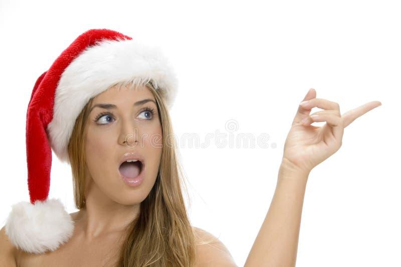 Indicating lady with santa cap royalty free stock images