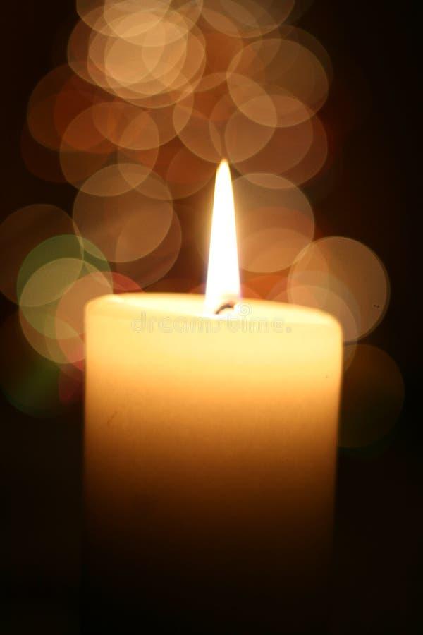 Indicatore luminoso della candela a natale immagine stock