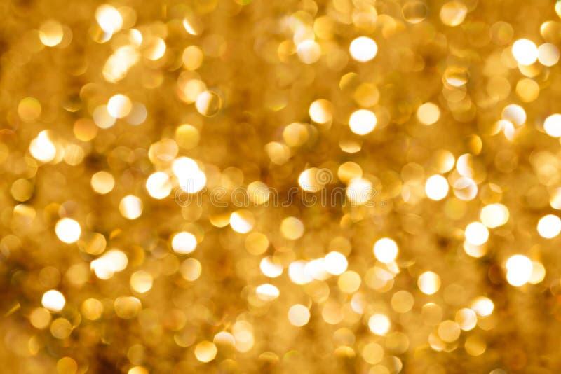 Indicatore luminoso di Bokeh dell'oro fotografie stock libere da diritti