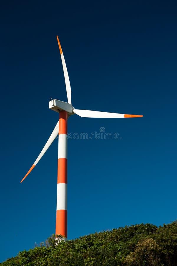 Indicatore luminoso di Sun sul mulino a vento fotografia stock